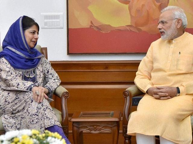 Jammu and Kashmir chief minister Mehbooba Mufti interacts with Prime Minister Narendra Modi in New Delhi on Wednesday.