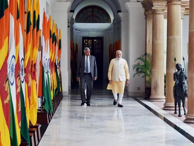 Prime Minister Narendra Modi with his Sri Lankan counterpart Ranil Wickremesinghe before their meeting at Hyderabad House, in New Delhi on Wednesday.