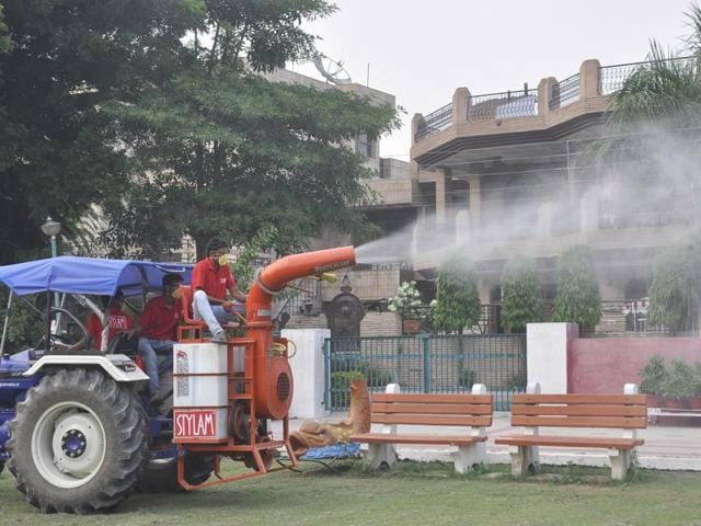 Fogging being done at a park in Panchkula's Sector 12 on Tuesday evening.