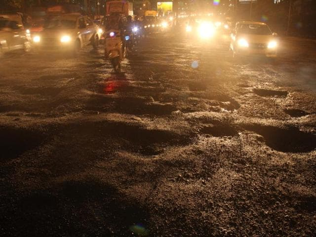 Potholes at Western Express Highway in Vile Parle that caused traffic jams on Wednesday.