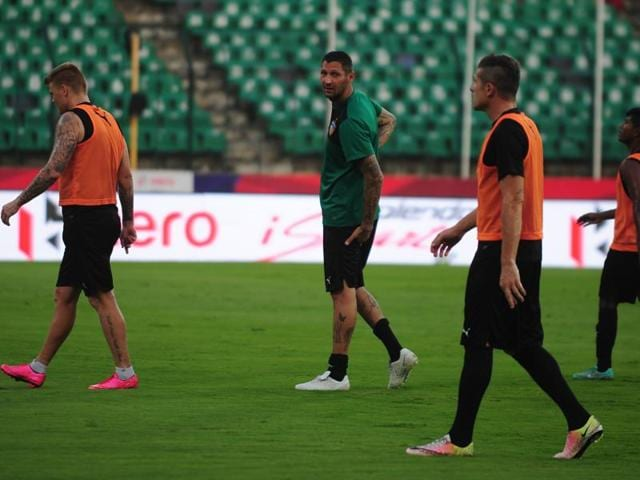 Marco Materazzi oversees a practice session.