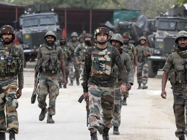 Indian Army soldiers patrol outside their base camp in Langate 75 kilometers north of Srinagar, Jammu and  Kashmir,  Thursday, Oct 6, 2016.  Security forces foiled an attack on an army camp and killed seven militants including three who tried to attack an army camp in northern Kashmir.