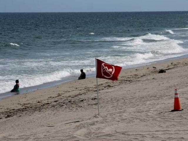 A red danger banner is seen on Pompano beach near Coral Springs while Hurricane Matthew approaches in Florida, US.
