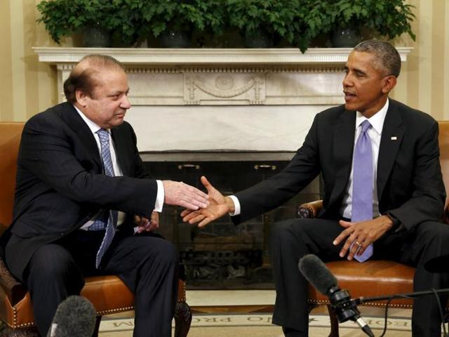 Pakistan's Prime Minister Nawaz Sharif interacts with US President Barack Obama at the Oval Office of the White House in Washington.