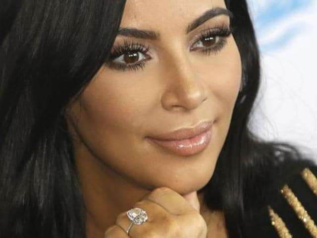 """According to her publicist, Kardashian was """"badly shaken but physically unharmed."""" She said nothing to waiting media upon her arrival."""