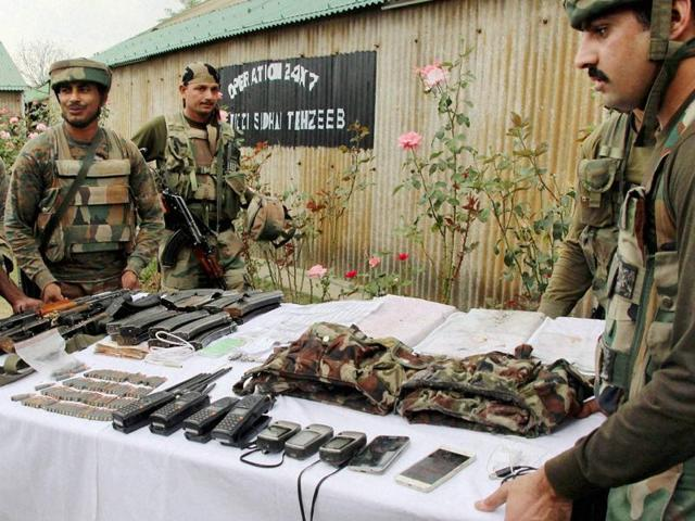 Army soldiers display the arms and supplies recovered during the combing operations in Langate, Handwara, on October 6, 2016.