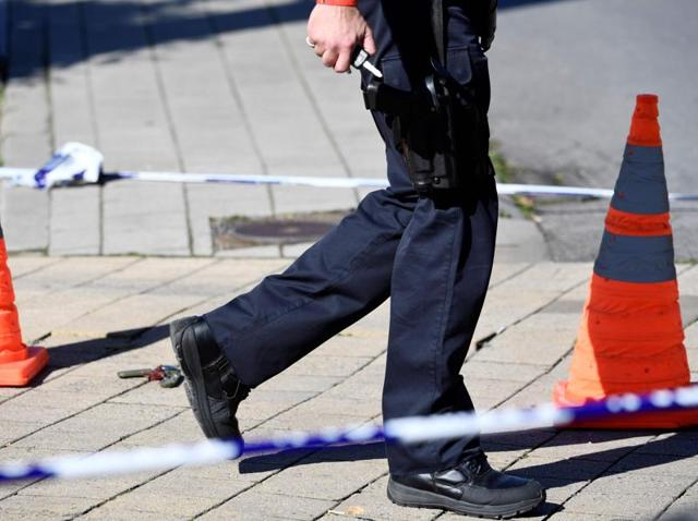 A security perimeter set around n the scene where two police officers were stabbed on October 5, 2016 in the Schaerbeek neighbourhood, in Brussels.
