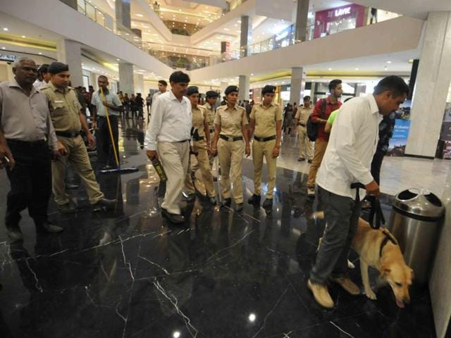 Police personnel carrying out checking at Elante Mall in Industrial Area, Chandigarh, on Thursday.