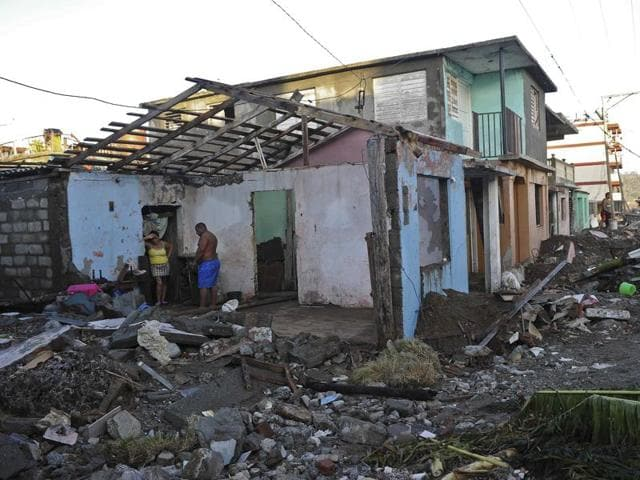 Inhabitants of Baracoa, Guantanamo province, east of Cuba clean up after hurricane Matthew passed through Haiti.