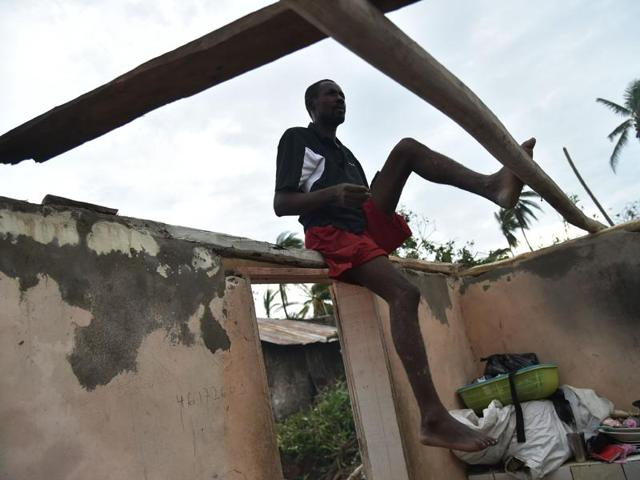 Residents repair their home after the passing of Hurricane Matthew in Sous Roche in Les Cayes, Southwest Haiti on Thursday.
