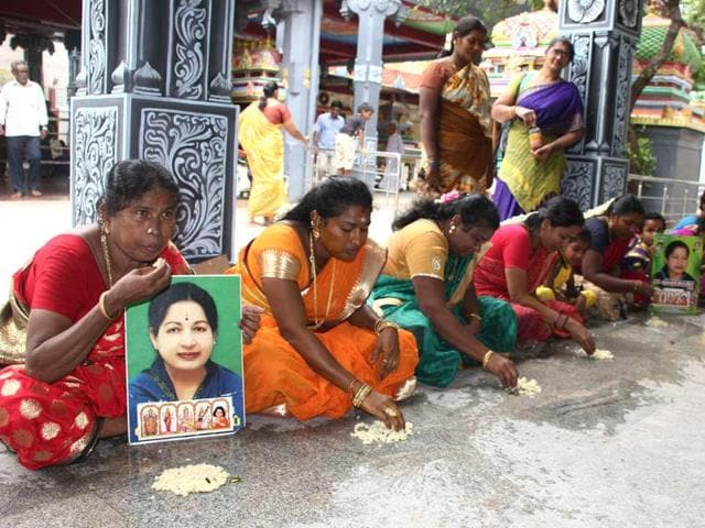 AIADMK women wing members eat food off the floor (a superstitious belief in south India) for a speedy recovery of party supremo and chief minister Jayalalithaa.