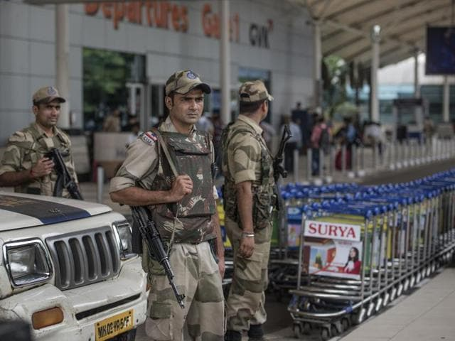 Members of the Central Industrial Security Force (CISF) stands guard at the Mumbai domestic airport.