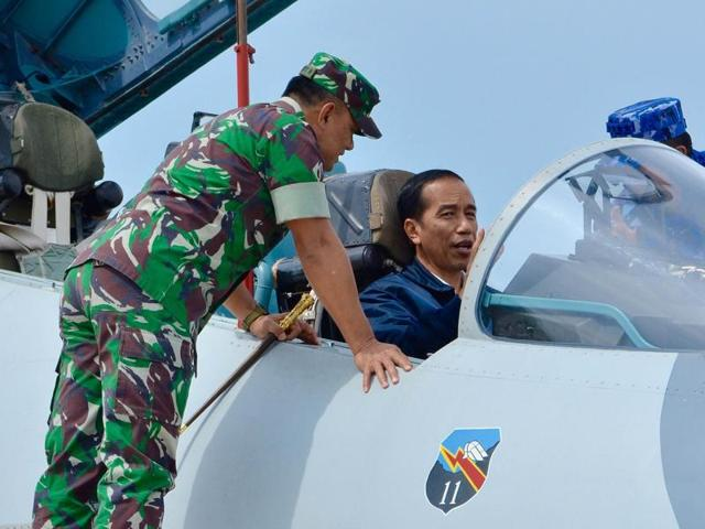 Indonesia's President Joko Widodo sits in the cockpit of a Sukhoi fighter jet as he attends a military exercise at Ranai military airbase in Natuna Island, Riau Islands province, Indonesia October 6, 2016.