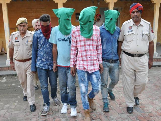 The four accused in police custody in Jalndhar on Thursday.