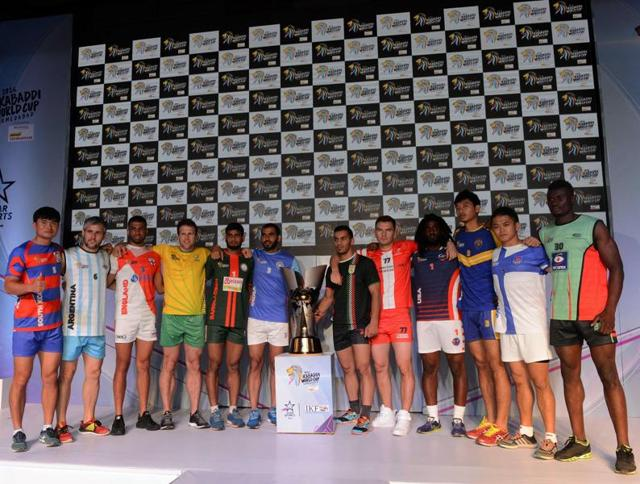 Captains of the 12 competing teams pose during the unveiling of the 2016 Kabaddi World Cup trophy in Ahmedabad on October 6, 2016.