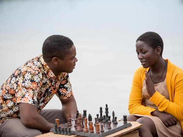 Mentored by an altruistic coach (David Oyelowo), the precocious protagonist  Madina Nalwanga (right) displays a natural aptitude for complex chess moves.