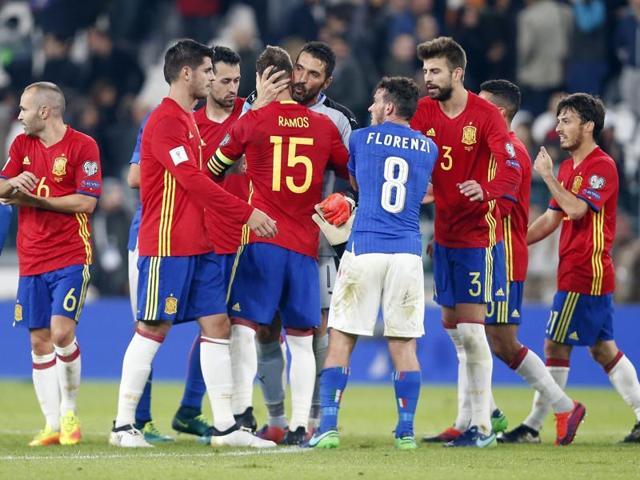 Italy goalkeeper Gianluigi Buffon hugs Spain's Sergio Ramos at the end of the match.