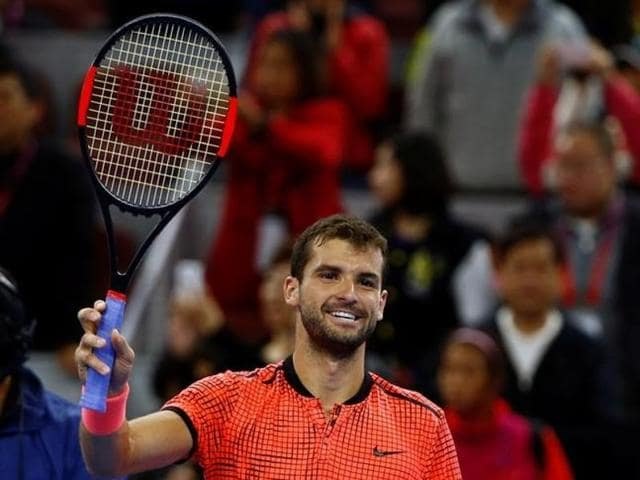 Grigor Dimitrov of Bulgaria reacts after winning a point against Rafael Nadal of Spain.