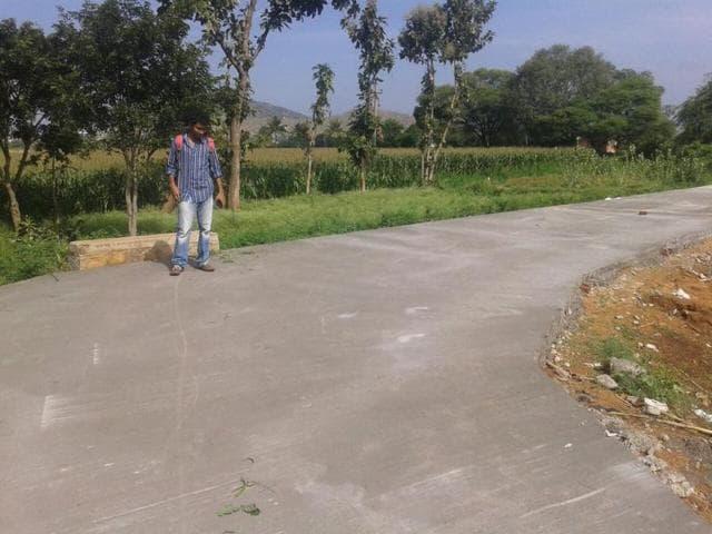Professor Nemkumar Banthia (centre) in Thondebavi village in Karnataka where the new self-repairing road, based on advanced technology, was built recently.(Courtesy UBC)