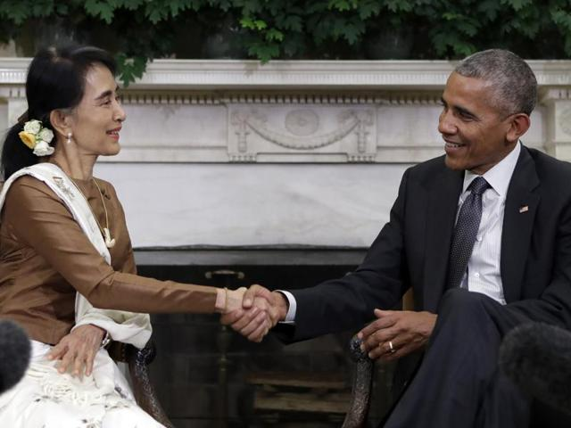 In this Sept. 14, 2016, photo, President Barack Obama and Myanmar's leader Aung San Suu Kyi shake hands as they speak to media at the conclusion of a meeting in the Oval Office of the White House in Washington. Obama on Friday lifted US economic sanctions on the former pariah state of Myanmar, the culmination of years of rapprochement that Obama has worked to facilitate.