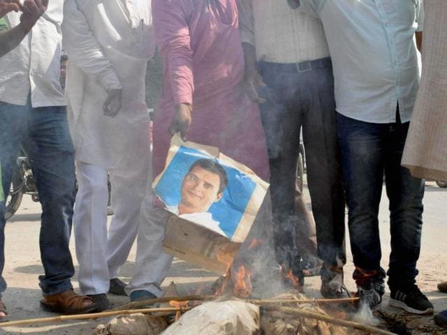 BJP workers burn the photographs of Congress vice-president Rahul Gandhi in Allahabad on Saturday.