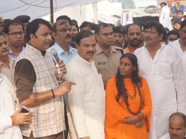 BJP MLA Sangeet Som addresses the crowd at Bisada with union minister Mahesh Sharma.