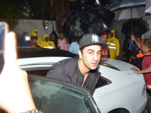 Randhir Kapoor and Ranbir Kapoor participate in a procession for the immersion of R K Studios idol of Lord Ganesh on the final day of the Ganesh festival, in Mumbai, on Sept 15, 2016.