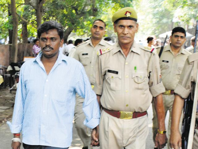 The prime accused in the Nithari case Surinder Koli (left) was awarded death penalty on Friday.