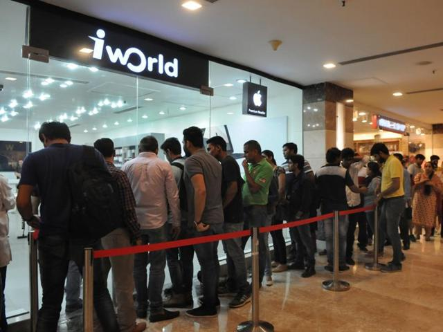 People wait outside an Apple store during the launch of iPhone 7 at Ambience Mall, in Gurgaon.