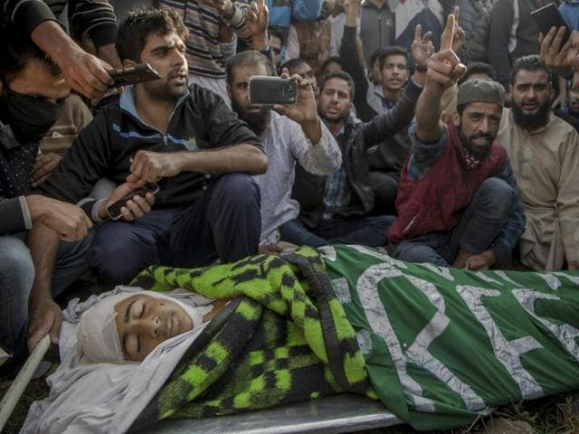 Kashmiri Muslims women comfort wailing mother of Junaid Ahmed, a 13-year-old boy during his funeral procession in Srinagar, Jammu and Kashmir, Saturday, Oct. 8, 2016.