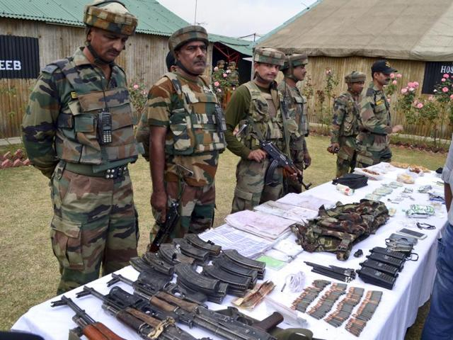 Soldiers display arms and ammunition at an Army camp in Langate, Handwara, some 75 kilometers north of Srinagar, October 6, 2016.