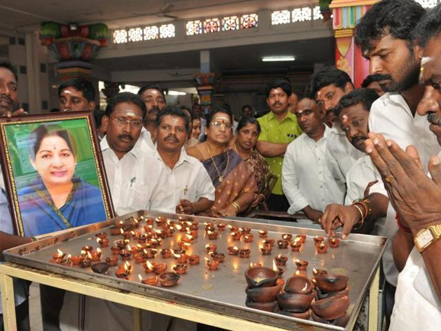 AIADMK members offer prayers at Lord Murugan Temple for speedy recovery of Tamil Nadu CM Jayalalithaa, in Coimbatore.