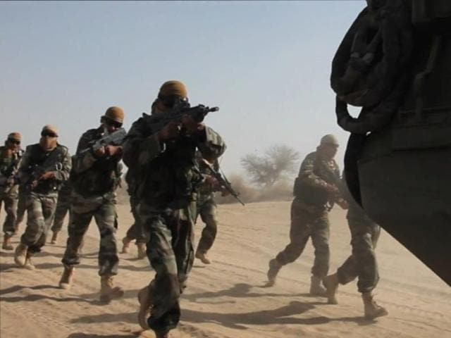 A file photo of Indian Special Forces crossing a riverbed while training. Their professionalism and dedication to their craft has ensured that we can strike at will against terrorists and their infrastructure across the Line of Control'.