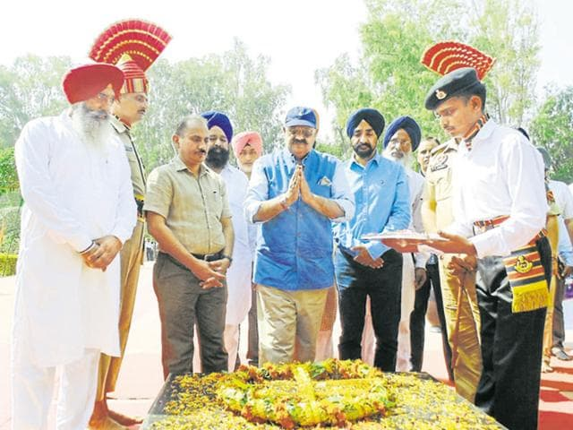 Punjab Governor VPS Badnore (centre) paying tributes to martyrs at Hussainiwala in Ferozepur on Saturday.