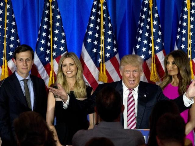In this June 7, 2016 file photo, Republican presidential candidate Donald Trump, joined by his wife Melania, daughter Ivanka and son-in-law Jared Kushner, speaks during a news conference at the Trump National Golf Club Westchester in Briarcliff Manor, New York.