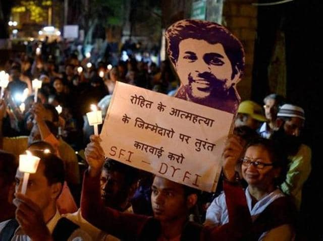 Students participate in a candle ligh march  in Mumbai to protest against Dalit scholar Rohith Vemula's suicide inside the Hyderabad University campus.