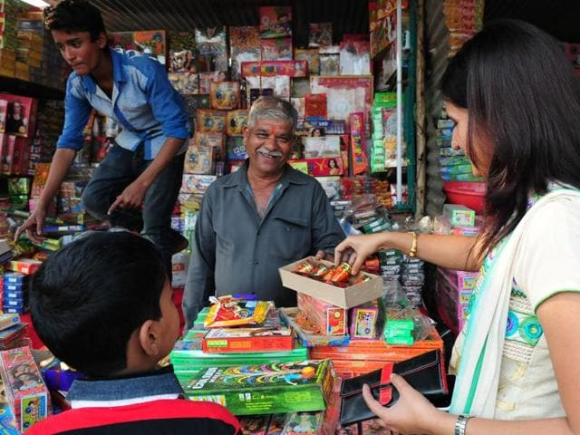 Bhopal:  People purchasing crackers from a Diwali crackers market on the eve of Diwali in Bhopal, India, on Tuesday.