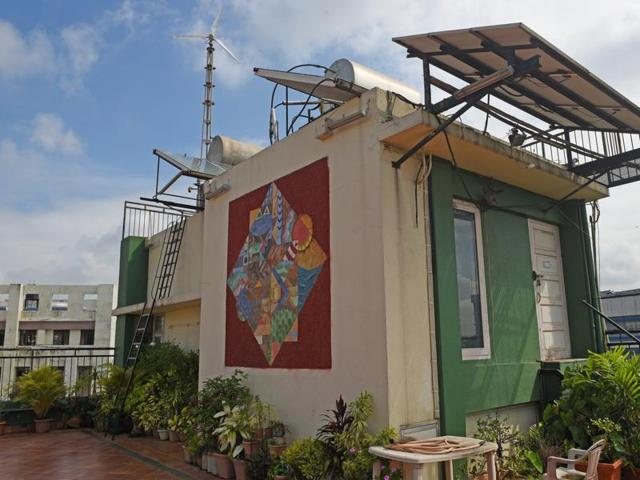 The windmill and solar panel set up at Dolat building in Vile Parle (West).(Pratik Chorge/HT)