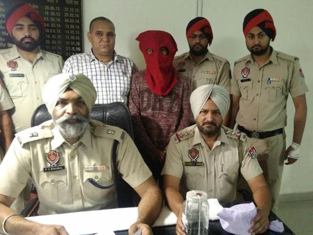 The accused in police custody in Jalandhar on Saturday.