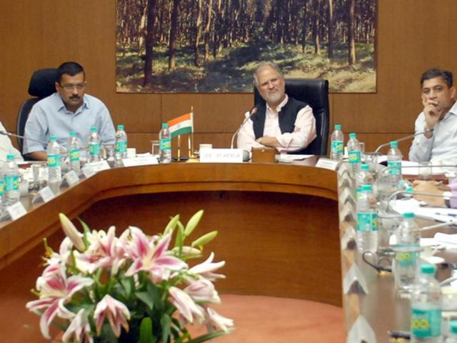 In this file photo, Lt. Governor of Delhi, Najeeb Jung, chief minister Arvind Kejriwal and health minister Satyendra Jain hold a meeting on dengue and chikungunya at Raj Niwas in New Delhi.