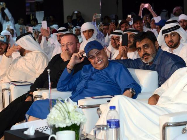 Dubai-based Indian businessman Balwinder Sahani, centre, during an auction in Dubai.