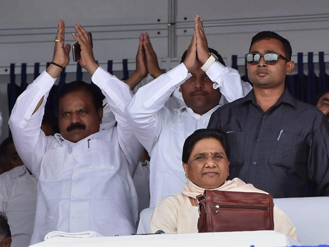 BSP supremo Mayawati with party workers at a function to commemorate the tenth death anniversary of the party founder Kanshiram in Lucknow on Sunday.