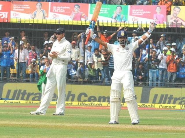 Cricket fans in Indore celebrate India's good performance.
