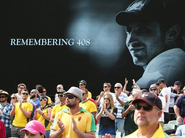 A tribute to Phillip Hughes is displayed outside a car dealership on December 2, 2014 in Macksville, Australia. Cricket player, Phillip Hughes passed away aged 25, as a result of head injuries sustained during the Sheffield Shield match on 25th November.