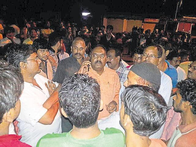 Former BJP MLA Bhagat Netam (talking over phone) outside the Baihar police station on the night of September 25.
