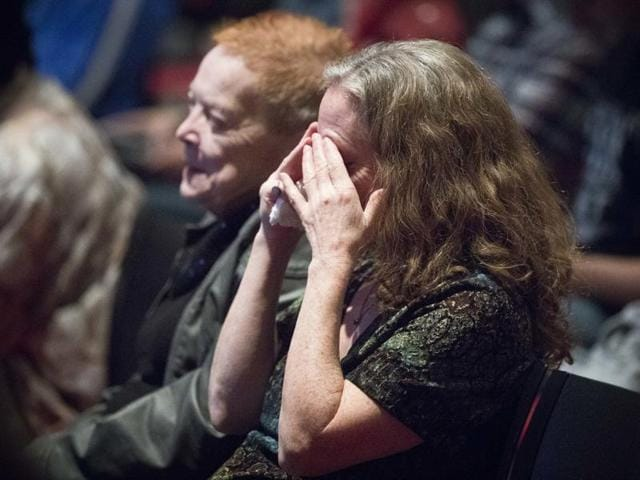 Viewers react as they watch the second presidential debate at a watch party at the University of Cincinnati on Sunday.