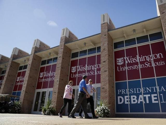 People walk by the debate site ahead of the second presidential debate at Washington University, in St. Louis.