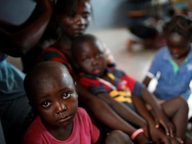 Children sit at a shelter after Hurricane Matthew passes in Jeremie, Haiti, on Sunday.