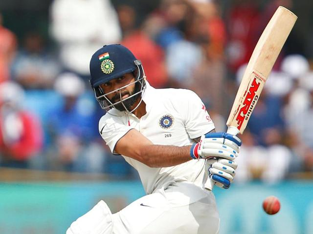 India's Virat Kohli celebrates his double century.