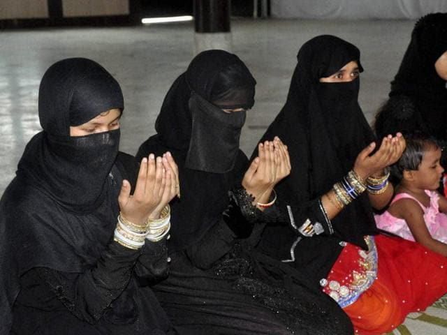 Lucknow: Muslim women offering namaz on the occasion of Eid-ul-Fitr at Eidgah in Lucknow on Wednesday. Women offered namaz at the Eidgah for the first time. PTI Photo (PTI7_7_2016_000158B)